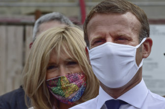 French President Emmanuel Macron and his wife Brigitte Macron wearing protective face masks on Friday.