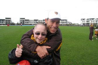 Sam Zwartz meeting Hawthorn coach Alastair Clarkson in May 2011.
