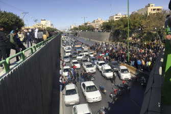 Cars block a street during the protests against a rise in petrol prices, in Isfahan last month.