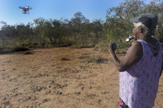 Annie Nayina Milgin, senior Nyikina cultural custodian, directing a drone in the Kimberley as part of research into the story of Woonyoomboo the Night Heron.