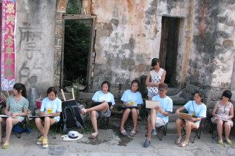 Wang Liqiang with other students at art school in Hong Kong.
