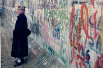 Anna Funder beside the Berlin Wall in 1988, the year before it came down.