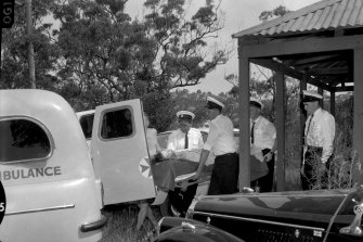 Shark-attack victim Marcia Hathaway is carried into a waiting ambulance on January 28, 1963