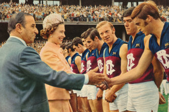 Queen Elizabeth meets Fitzroy players during the first VFL match played on a Sunday, on April 5, 1970.