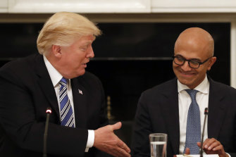 Donald Trump with Microsoft chief Satya Nadella. Amazon claimed the former US president stepped in to thwart its bid for the lucrative contract.