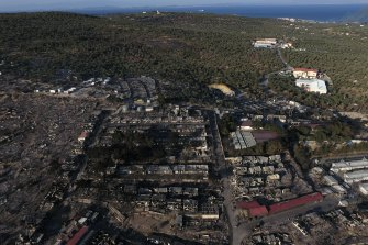 The burnt Moria refugee camp is seen from above. A third fire burnt what was left from the camp on Thursday.