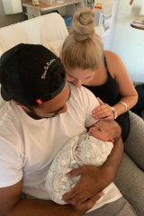 Rob Jennings with his partner Samantha and newborn Willow
