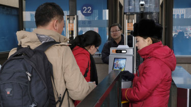Passengers use the new facial recognition system at Beijing Railway Station.