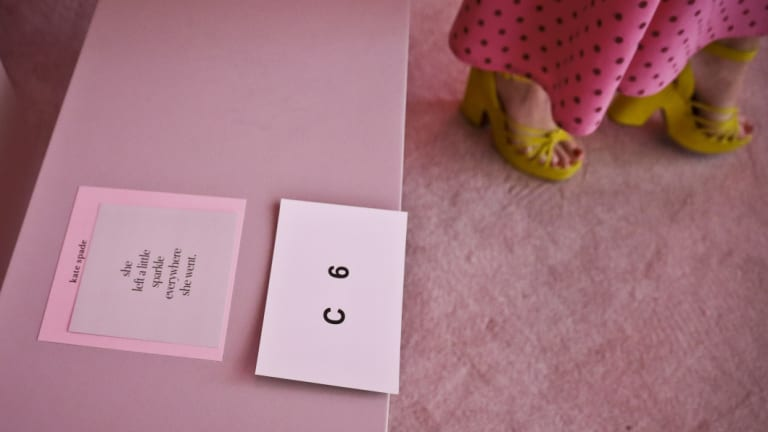 A tribute card to the late fashion designer Kate Spade is placed on seats for arriving guest the collection show during New York Fashion Week.