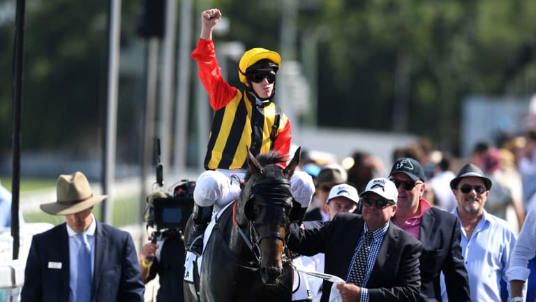 Salute: Tim Clark celebrates after winning the Magic Millions Guineas with Boomsara after a thrilling finish.