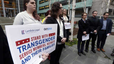 Transgender-rights activists protest outside a US federal court.