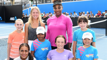 Fighting for the future: Serena Williams, a leading advocate for equal gender prizemoney at all tournaments, poses with junior Australian tennis players at Melbourne Park.