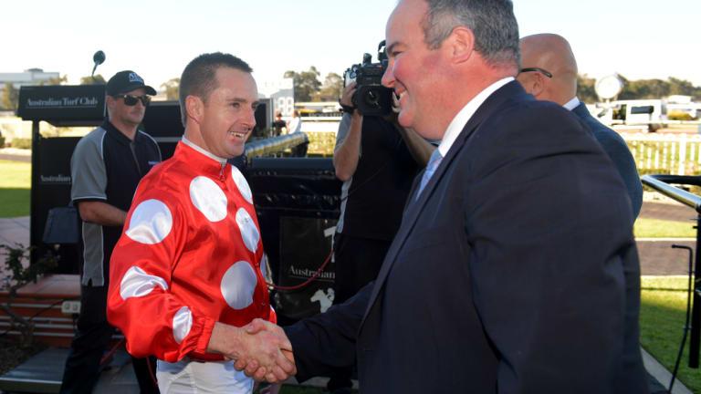 On the rise: Brad Widdup congratulates jockey Christian Reith after a win.