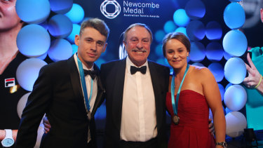 John Newcombe with reigning Newcombe medallists Ashleigh Barty and Alex de Minaur.