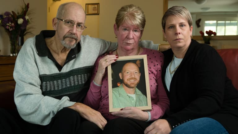 Joy and Mike Van Duinen, with their daughter, Tracey Filocamo, holding a photo of Gary Van Duinen, who took his own life after a 13-hour gambling binge on Sydney's northern beaches.