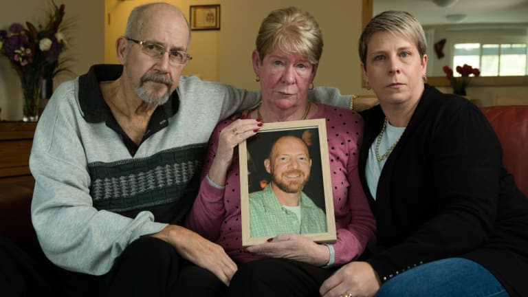 Joy and Mike Van Duinen, with their daughter, Tracey Filocamo, holding a photo of Gary Van Duinen who took his own life after a 13-hour gambling binge.