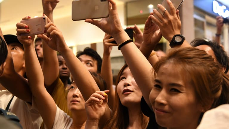 Crowds gathered to cheer for Kim Jong-un as he arrived at the Marina Bay Sands.