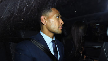 Awaiting his fare: Israel Folau leaves a Sydney law firm on Tuesday.