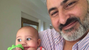 Hazem Hamouda,with his granddaughter, Aveline.