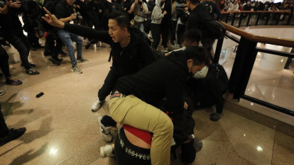 Hong Kong police fire tear gas to disperse Christmas Eve protesters