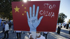 A protester from the Uighur community living in Turkey, holds an anti-China placard during a protest in Istanbul.