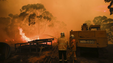 RFS firefighters tackle a fire at Bombay, NSW.