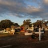 'It's not in any of the fine print': Coffins flooded at Brisbane cemetery