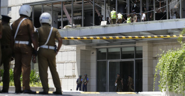 Police and forensic officials at the Shangri-la hotel in Colombo after Sunday's attack.