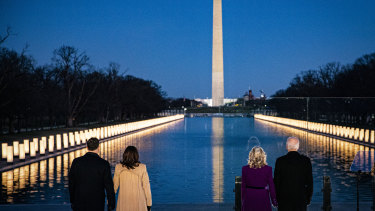 US President-elect Joe Biden, from right, wife Jill Biden, US Vice-President-elect Kamala Harris and husband Douglas Emhoff stand at the Lincoln Memorial Reflecting Pool on the eve of the inauguration.