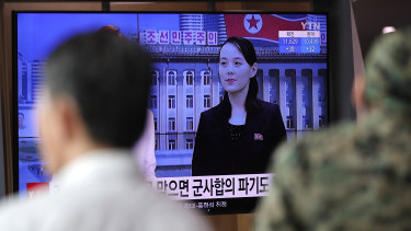 A man watches a TV news program with a file image of Kim Yo-Jong, the powerful sister of North Korea's leader Kim Jong-un, at the Seoul Railway Station in Seoul.
