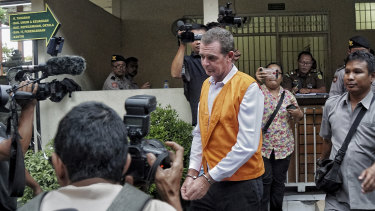 Johnsson taken to court room for his first trial at Denpasar district court.