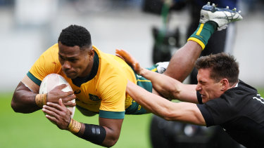 Wallabies debutant Filipo Daugunu goes over for a try against New Zealand.