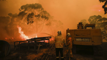RFS firefighters tackle a fire at Bombay, NSW. The market operator has warned of blackout risks during a forecast hot summer.