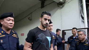 Thai prison guards lead Bahraini football player Hakeem al-Araibi from a courthouse in Bangkok.