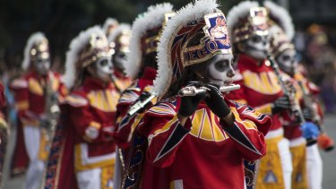 Performers participate in the Day of the Dead parade in Mexico City, last month.