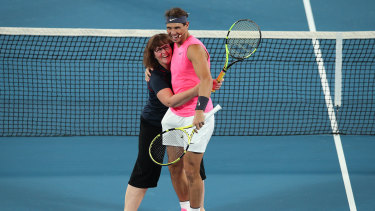 Ms Borg hugs Nadal during a game of mixed doubles.
