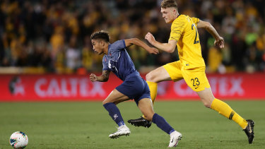 Abhishek Rijal of Nepal takes on Harry Souttar of the Socceroos.
