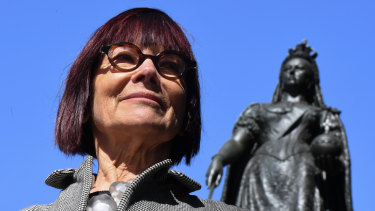 Professor Jenny Hocking, with a statue of Queen Victoria behind her, is taking her fight to release correspondence between Queen Elizabeth and former governor-general Sir John Kerr over the Dismissal to the High Court.