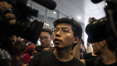 Joshua Wong addresses protesters on Monday.