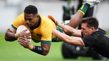 Wallabies debutant Filipo Daugunu goes over for a try against New Zealand.
