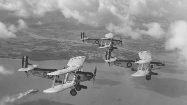Royal Air Force biplanes flying in formation.