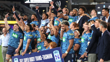 Skipper Patrick Tuipulotu holds up the trophy after the Blues broke their title drought.