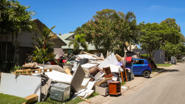 Damaged household possessions were piled up on the footpath in Idalia in the flooding aftermath.