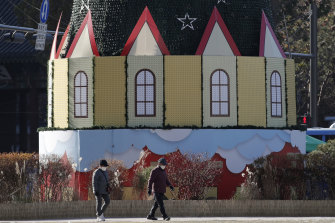 People walk near a Christmas decoration in Seoul, South Korea, on Thursday.