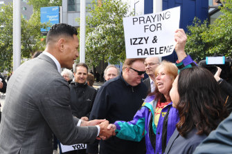 Israel Folau was greeted by supporters on his arrival at the Federal Court on Monday before a settlement was reached.