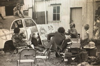 Outside painter John Bell's studio at Dunmoochin, Victoria, 1969. Louise is on the car; Tim, at far right, stands behind John Olsen.