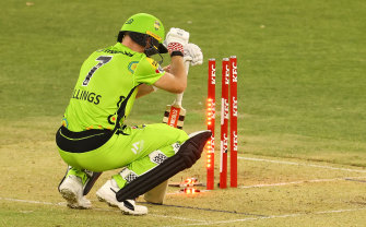 Sam Billings slumps to the ground after being dismissed in Perth on Saturday night.