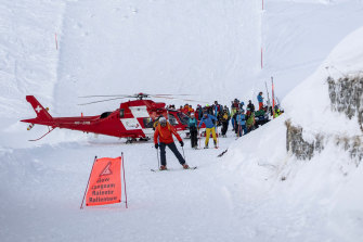 Rescuers search for possible victims after an avalanche swept down a ski piste in Andermatt, Switzerland.