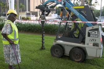 Nancy McDinny supervises a mini-bulldozer drilling on the Northern Territory Parliament's lawn in Darwin in April as part of a group of traditional owners protesting against fracking proposals for their land.