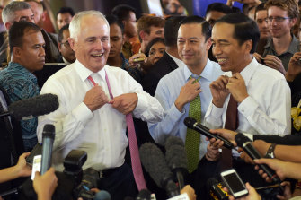 Comfort zones: Malcolm Turnbull and Joko Widodo take off their ties during a visit to Jakarta's Tanah Abang market in November 2015.